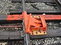 derail device installed on a siding at Glen Haven, Wisconsin .: https://en.wikipedia.org/wiki/Derail