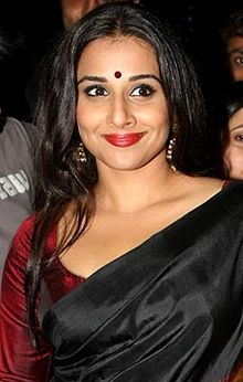 Vidya Balan is smiling at the camera.