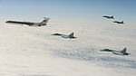 """Vigilant Eagle 13 - Overall with Royal Canadian CF-18 Hornets, the """"TOI"""" aircraft, and Russian Federation Fighters 130828-F-XX999-008.jpg"""