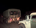 Volunteers from the Oklahoma Nation Guard are trucked in with US Army 5-ton trucks and High-Mobility Multipurpose Wheeled Vehicles (HMMWV) to serve as guards at checkpoints surrounding the affected area where DF-SD-00-03215.jpg