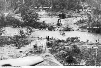 Invasion of Buna–Gona - The crossing of the Kumusi River at Wairopi later in the campaign. AWM128149