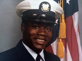 Portrait photo of Walter Scott in U.S. Coast Guard uniform with an American flag partially visible in the background.