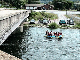 Hunter, Tennessee - Whitewater rafters floating downstream by the Hunter Bridge put-in on the Watauga River.