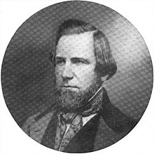 Photograph of a man facing left, with chin beard and longish hair
