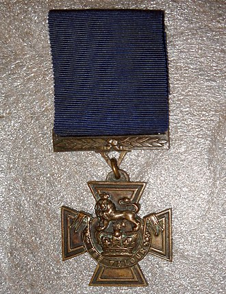 Victoria Cross - The obverse of William Johnstone's VC showing the dark blue ribbon for pre-1918 awards to naval personnel.