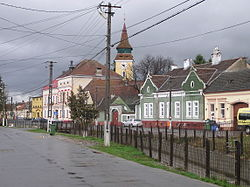 Main street of Vulcan with the fortified church in the background