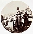 Woman at a market stall (2781021868).jpg