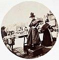 Woman at a market stall (2781021868).jpg