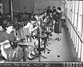 Women volunteers operating knitting machines (taken for Australian Comforts Fund), by Sam Hood March 1944 (14173769095).jpg