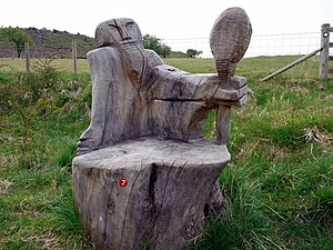 English: Wooden seat sculpture, Harehope Quarr...