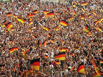 German football fans during the 2006 FIFA World Cup. Some flags seen here contain the federal coat of arms and must not be confused with the state flag, which displays the Bundesschild.