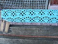 Yarn Bomb - park bench seat (5520839473).jpg