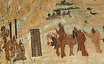 Mural in brown-reddish colors showing one on a hors and several people on foot.