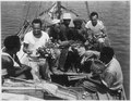 """""""34th CB's trading with natives from Malaita. Left to right, native, Percy J. Hope, MS2c, Lilton T. Walker, S1c, two nat - NARA - 520630.tif"""