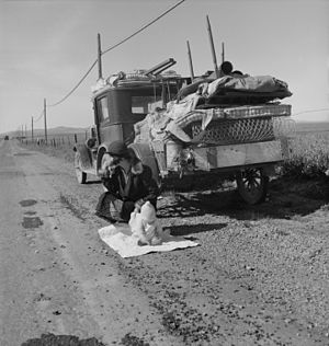 "Dust Bowl - ""Broke, baby sick, and car trouble!"" - Dorothea Lange's 1937 photo of a Missouri migrant family's jalopy stuck near Tracy, California."