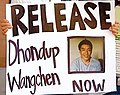 """RELEASE Dhondup Wangchen NOW"" sign, 2009 New York City Protesters Demand China to Release Filmmaker of ""Leaving Fear Behind"" Dhondup Wangchen (cropped).jpg"