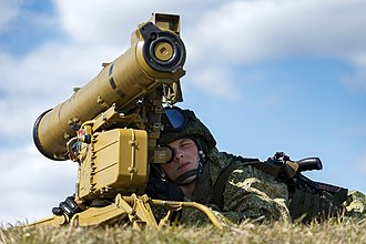 9M113 Konkurs - A Russian soldier with a 9M113 Konkurs missile.