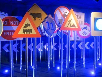 Warning sign - Exhibit mostly of warning signs (with some regulatory signs like Do Not Enter), Turin Automobile Museum