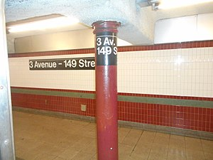 Third Avenue–149th Street (IRT White Plains Road Line) - The pillar and wall with their own signs as seen from the doors of a train.
