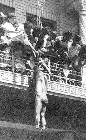 Arab Federation - Mutilated corpse of King Faisal's cousin 'Abd al-Ilah hanging from a balcony.