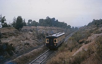New South Wales - A short-lived South Maitland Railway (SMR) Railcar travelling between Weston and Abermain, 1962. The SMR is notable for being the second last system in Australia to use steam haulage.
