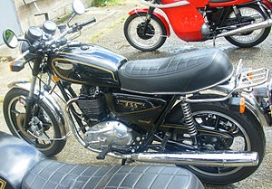 Triumph T140W TSS - 1982 UK/RoW specification Triumph TSS at the London Motorcycle Museum sporting the Morris alloy wheel option but also owner-fitted with some non-standard 1979 parts: Girling rear shock absorbers, handlebar levers and a grabrail with parcel carrier