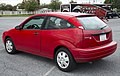 2007 Ford Focus SE (ZX3) in red, rear left at Hershey 2019.jpg