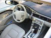 Top down view of V70 drivers area with beige interior and glossy wood trim