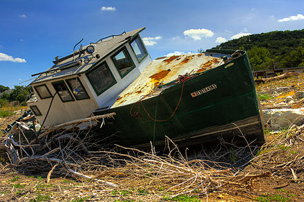 The 2011 Texas drought dried up many of central Texas' waterways. This boat was left to sit in the middle of what is normally a branch of Lake Travis, part of the Colorado River. 2011 Texas Drought.jpg