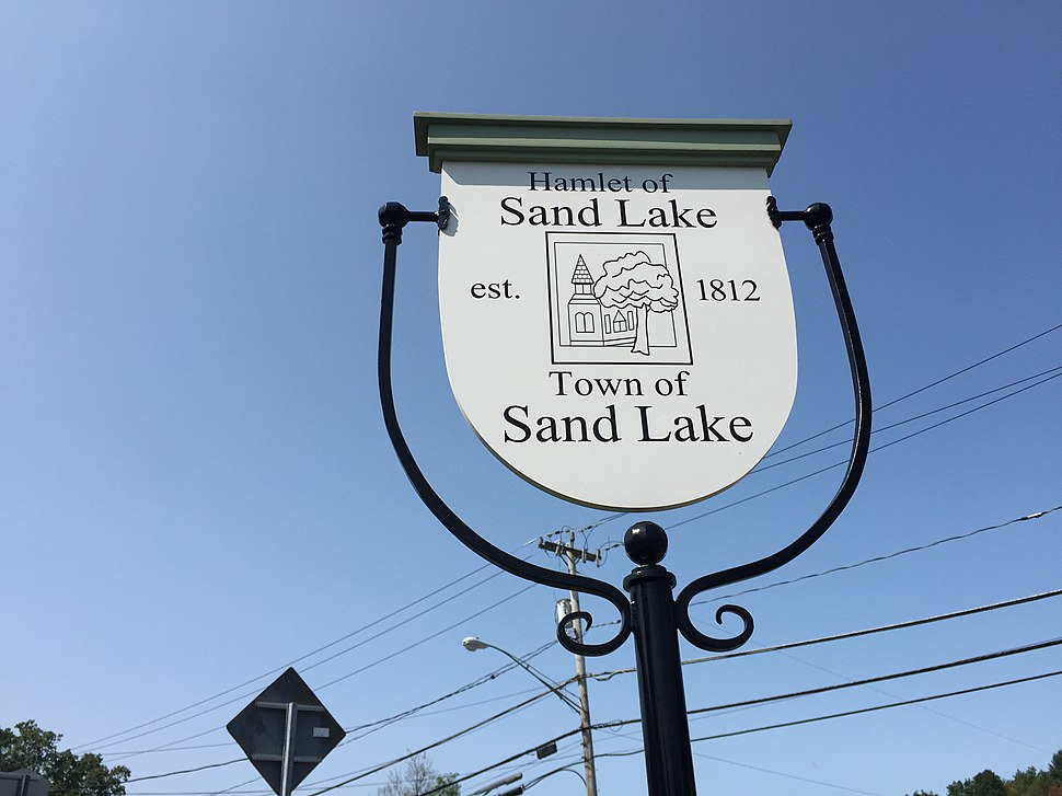 2017-09-10 12 28 14 Sign for the Hamlet of Sand Lake in the Town of Sand Lake at the intersection of New York State Route 43 and New York State Route 66 in Sand Lake, Rensselaer County, New York