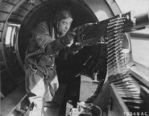 Maynard Harrison Smith - Smith manning a machine gun