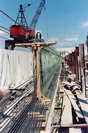 Prestressed concrete - Pre-tensioned bridge girder in precasting bed. Note single-strand tendons exiting through the formwork