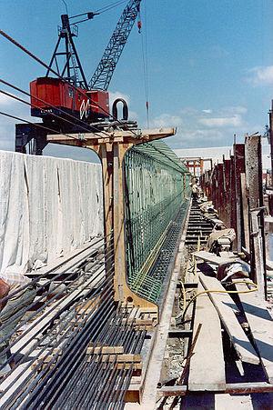 Prestressed concrete - Pre-tensioned bridge girder in precasting bed. Note single-strand tendons exiting through the formwork