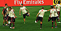 AC Milan players stretching.jpg