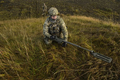 A 52nd Civil Engineer Squadron explosive ordnance disposal craftsman sweps an area with a mine detecto.png