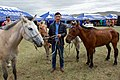 "A Man Holds a Group of Horses Before Secretary Kerry and Mongolian Foreign Minister Purevsuren as They Attend a ""Mini-Nadaam"" Outside Ulaanbaatar (27266112290).jpg"