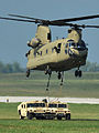 A U.S. Army CH-47 Chinook helicopter, with the 159th Combat Aviation Brigade, 101st Airborne Division, delivers two Humvees during air assault training at Campbell Army Airfield on Fort Campbell, Ky., Aug. 7 120807-A-SG577-002.jpg