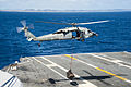 A U.S. Navy MH-60S Seahawk helicopter assigned to Helicopter Sea Combat Squadron (HSC) 25 delivers supplies to the flight deck of the aircraft carrier USS George Washington (CVN 73) Nov. 15, 2013, in 131115-N-IP531-166.jpg