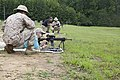 A business leader attending a Marine Corps Executive Forum (MCEF) fires an M27 rifle at a target under the supervision of a U.S. Marine aboard Marine Corps Base Quantico, Va., July 11, 2013 130711-M-MI461-332.jpg