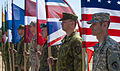 A color guard with flags representing participating countries stands at attention before the opening ceremony of Exercise Saber Strike at the Pabrade Training Area in Lithuania, June 3, 2013 130603-A-EQ309-001.jpg