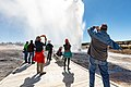 A group watches and photographs a Beehive Geyser eruption (47669954131).jpg