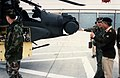 A lieutenant points out the forward-looking infrared (FLIR) sight on the nose of an AH-64 Apache helicopter to a member of the Pakistani army's general staff - DPLA - 6868fbad9b810db858042ca845510f23.jpeg