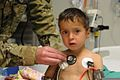 A medical doctor examines Farook, an Afghan child with his uncle, Shah Saied, after Farook, suffered an asthma attack, and obtained treatment at Forward Operating Base Salerno, Afghanistan, Dec. 10, 2011 120110-A-LB862-002.jpg