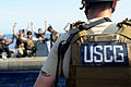 A member of the U.S. Coast Guard Maritime Safety and Security Team (MSST) 91104 orders visit, board, search, and seizure (VBSS) and other MSST members to raise their hands during VBSS training near 090826-N-ZL677-059.jpg