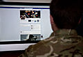 A serviceman accesses social media channels, using a desktop computer. MOD 45156050.jpg