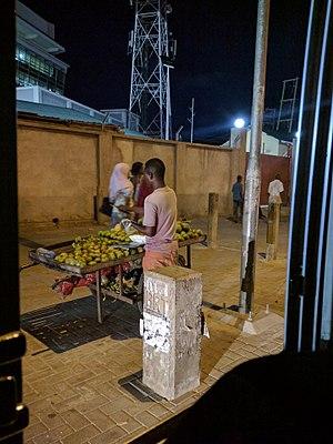 Hawker (trade) - A vendor in Dar es salaam selling fruit.