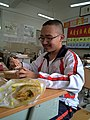 A student having lunch in Tieling High School.jpg