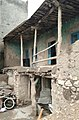 A typical Kurdish house with columned terrace at Rawansar, south of Hawraman.jpg