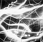 A vertical aerial photograph taken during a raid on Berlin on the night of 2-3 September 1941. The broad wavy lines are the tracks of German searchlights and anti-aircraft fire. C2056.jpg