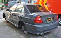 Abandoned Mitsubishi Lancer police car, Denpasar.JPG